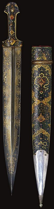 Persian / Caucasus qama (double edged dagger) 18th to 19th century, broad straight blade with central groove decorated with damascened cartouches of foliate motifs, horn and marine ivory grips with an intricate arabesque of lotus palmettes, scrolling tendrils and cloud-bands in gold and painted, scabbard with painted decoration and silver lower chape, the upper mount of steel with gold damascening, 58.7cm. 3 repins