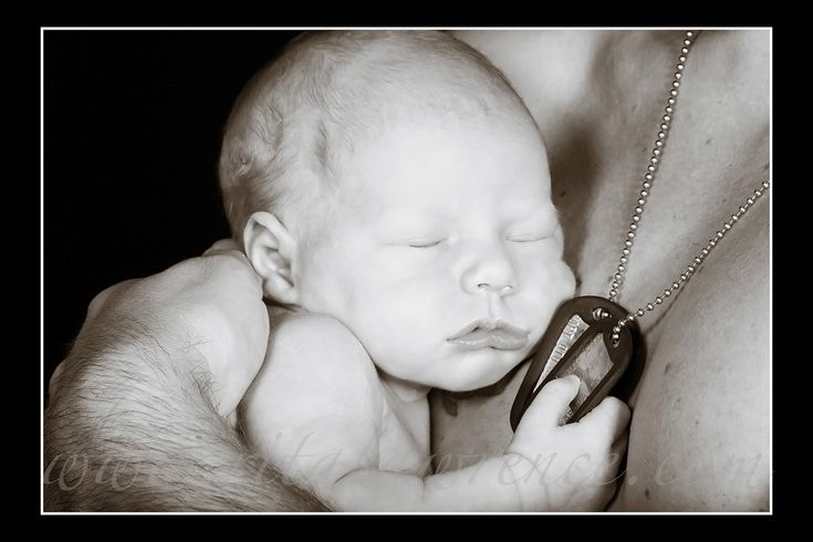 Another picture with just dog tags but super cute with baby laying on dads chest.