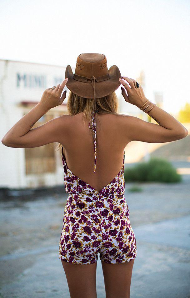 Jennifer Grace is wearing a tropical print jumpsuit