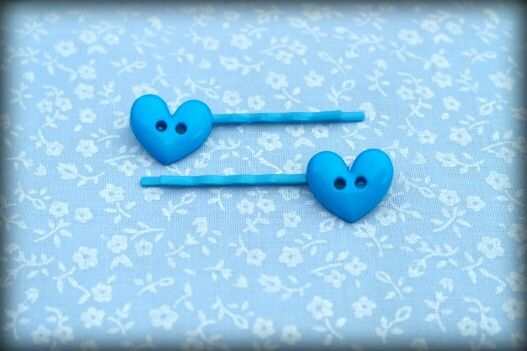 Cute button bobby pins on 5cm blue pin.  These and others available for sale at www.facebook.com/sewprettylisajean or email www.sew.pretty@hotmail.co.uk x