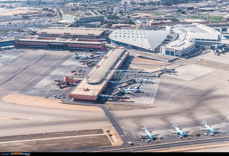 Cairo International Airport ~ Terminal 3 (2009) to the left and Terminal 2 (2016) to the right.