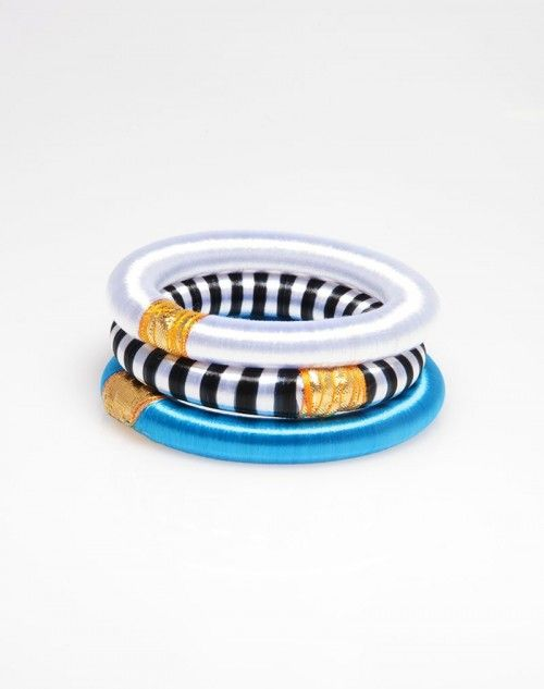 We took our preppy black and white striped silk bangle, flanked it with a shock of color, and tempered it with our elegant white silk bangle. Enjoy this stack of 3 bangles on the beaches of Milos. Perfect as an accessory or a gift! www.hamptonbanglecompany.com #bracelets #fashion #jewelry #trend #style #accessory #sexy #bangles  #imaginehappy