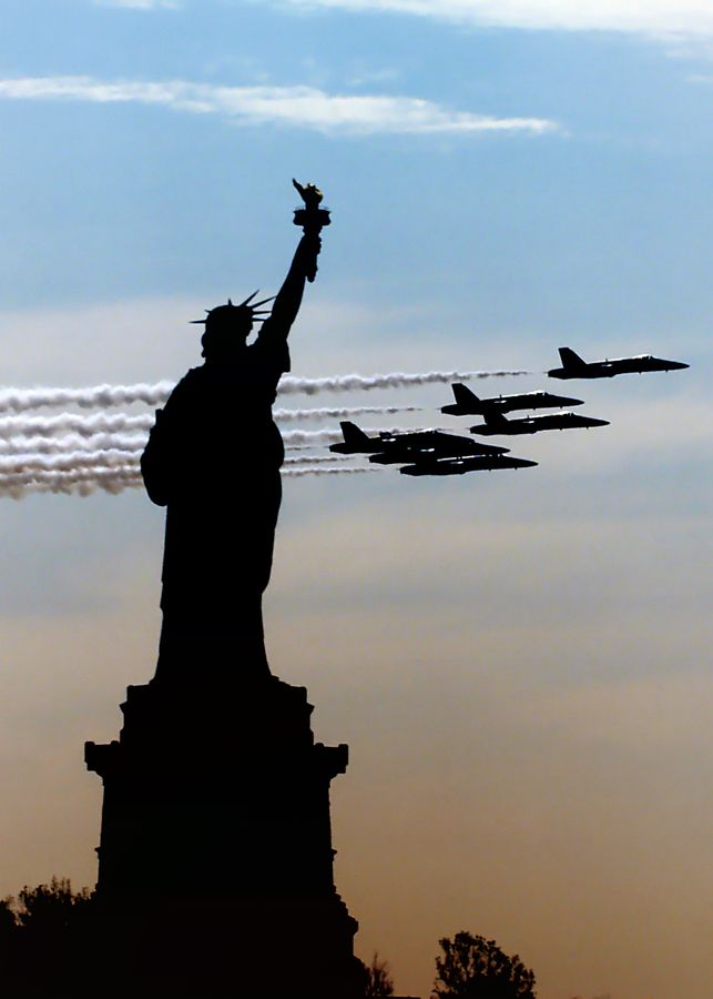 The Blue Angels fly by the Statue of Liberty
