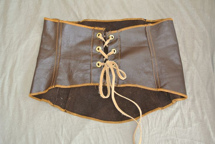 Brown Leather Corset 195.00 Smooth grain brown leather corset. Has gold grommets and contrast cord for cinching. A fall essential. Available in Brown and Black Genuine Leather.  Available in standard sizes or custom tailored using our TM Custom Experience Form at check out. Please allow 2 additional weeks (plus shipping) to tailor this item to your measurements. www.tanyamariedesign.com