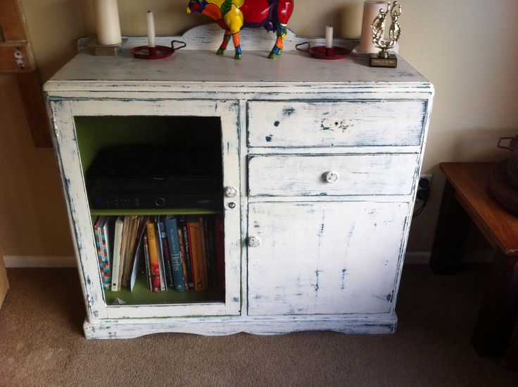 Distressed cabinet made into TV cabinet...