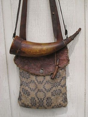 Ken Scott Pouches.  Nice horn on a woven pouch with leather flap.