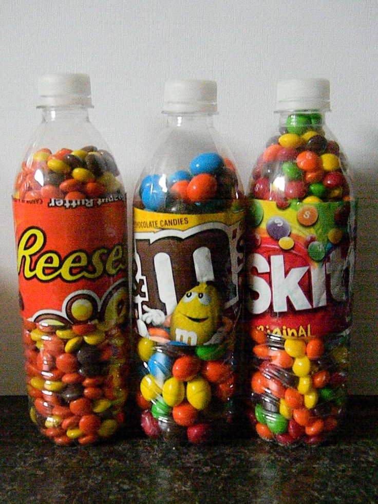 Love this idea ~ recycled water bottles ~ think I'd leave the labels off and do a ribbon and tag ~ if ya can't tell it's Skittles ~