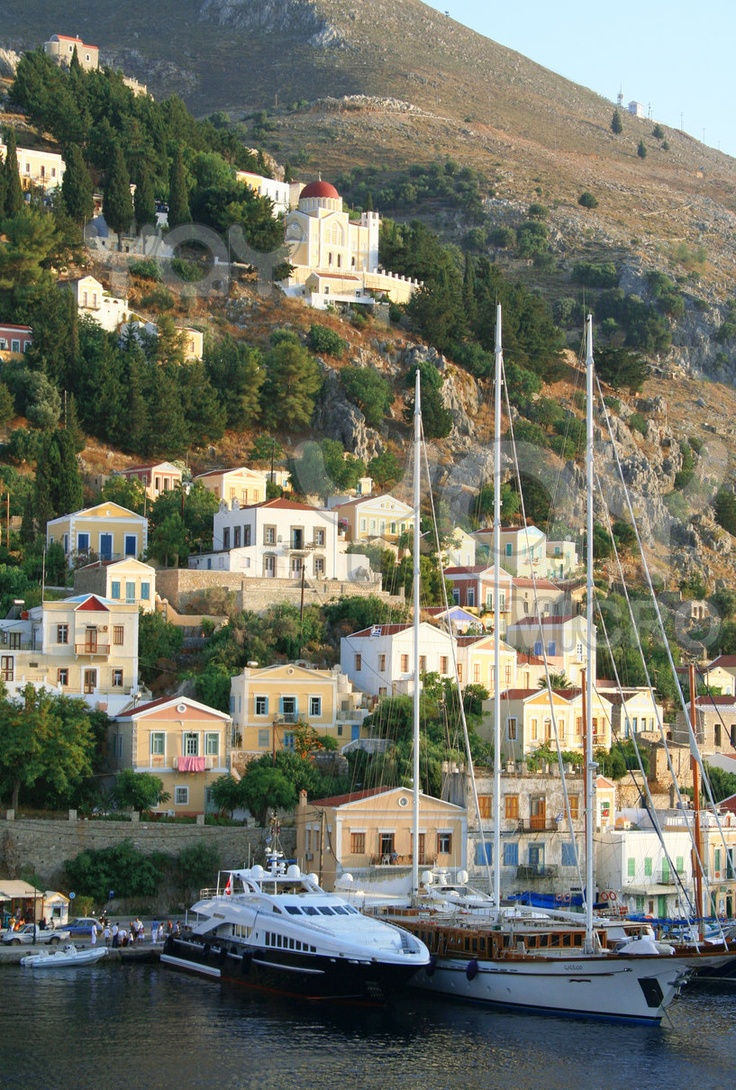 Greece. Aegean sea. Island Symi (Simi). Mandraki harbor in the evening