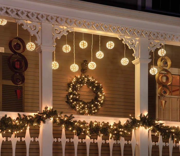 Christmas: love this - garland across the railing - want to replicate it! Outdoor  Christmas Decor PorchesChristmas ...