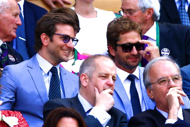 Bradley Cooper and Gerard Butler both made it to the tournament, donned in shockingly similar attire. The two A-list actors and off-screen pals were in attendance with Cooper's girlfriend, Suki Waterhouse, who was inexplicably absent from their candids.