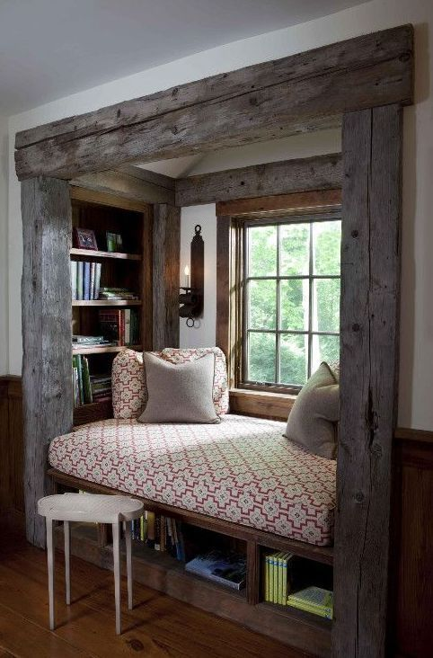 This rustic reading nook is basically a large window seat bench with built-in bookshelves. What an excellent idea!