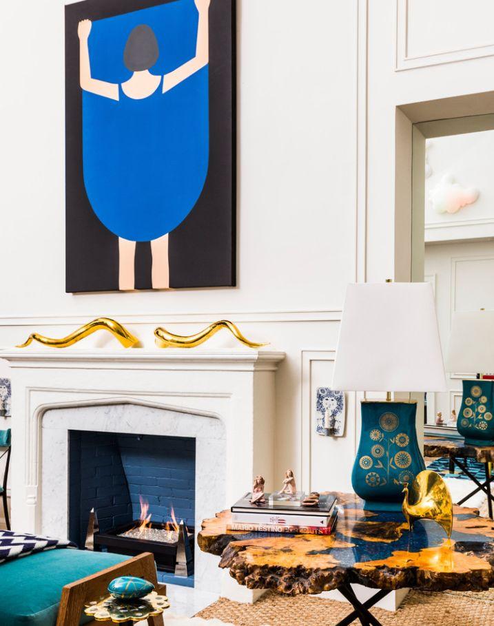 FOR THE LOVE OF GOLD: house envy: simon doonan + jonathan adler - gold horns fireplace - blue art