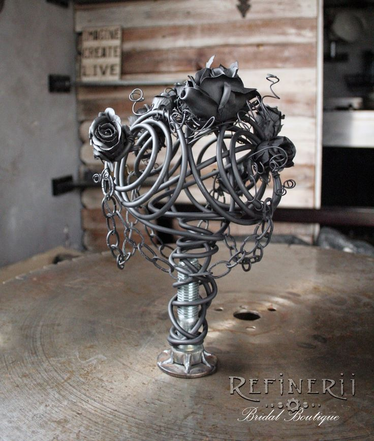Gothic wedding bouquet created from metal; a unique alternative to traditional flowers; perfect for the bride who really wants to make a statement.  Original deisign by Refinerii Bridal Boutique.