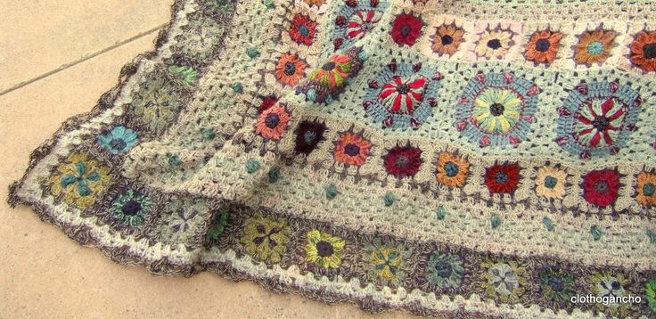 More circus blanket. I like the fine yarn mixed with a larger hook.....so different than how I approach crochet. Floaty soft mohair mix wool looks so pretty on a bigger hook. Note to self-Try it!!!!