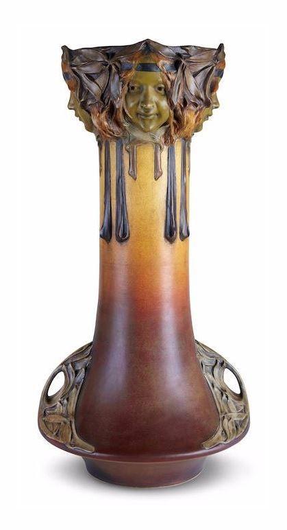 A monumental Julius Dressler glazed and molded ceramic vase. First quarter 20th century. With artist's raised cartouche impressed JBD, underside further impressed AUSTRIA 1021.