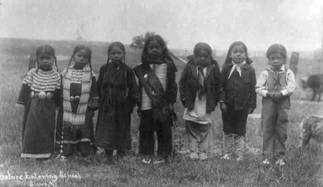 7 Sioux children in 1897 before entering school