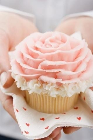 Ruffles & flower. Love it! cute idea instead of a huge cake. cupcakes. Sweet to serve to the guests at the wedding instead of cake!