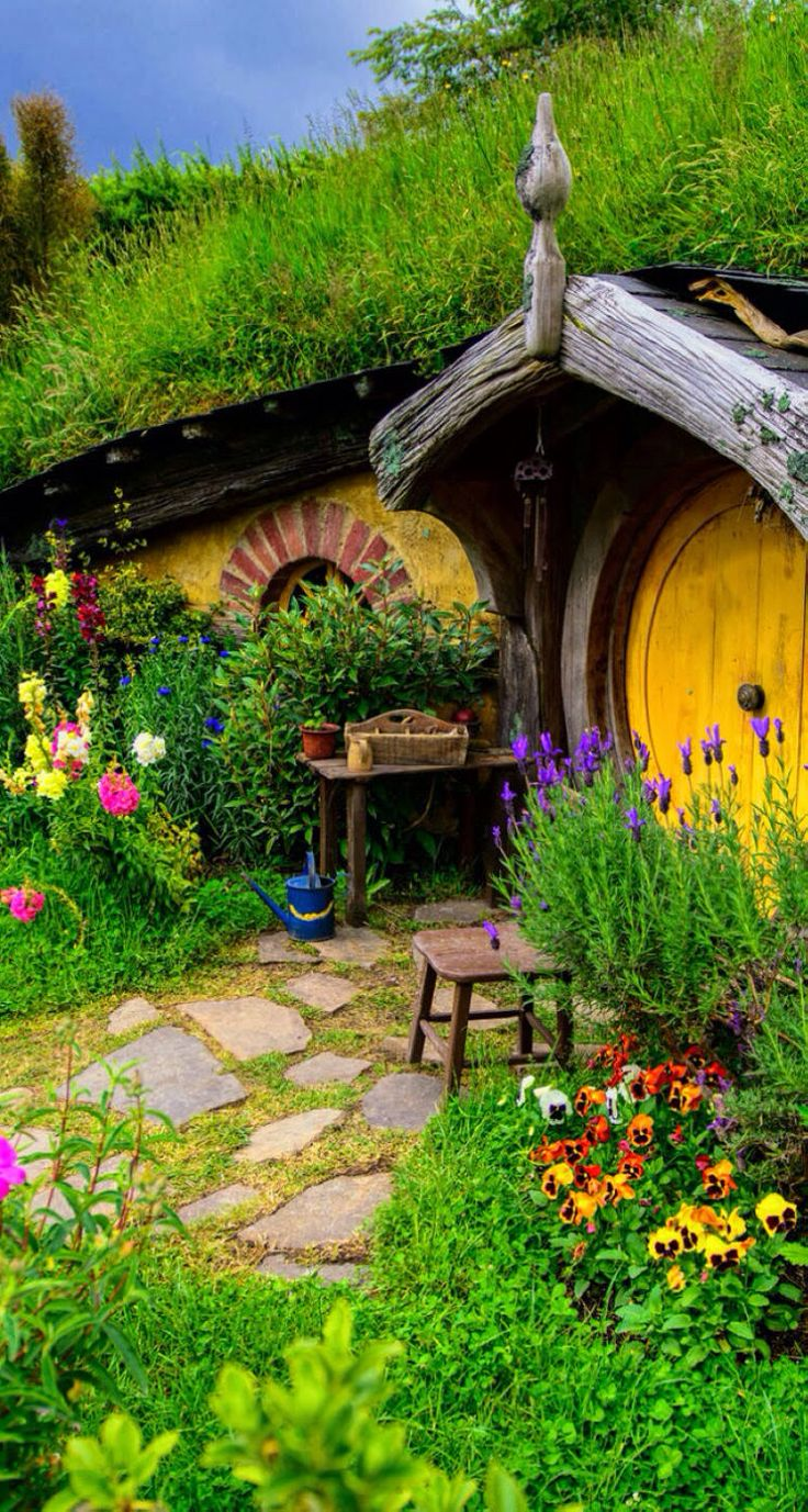 This is the outside of our Hobbit House. I am loving the flowers