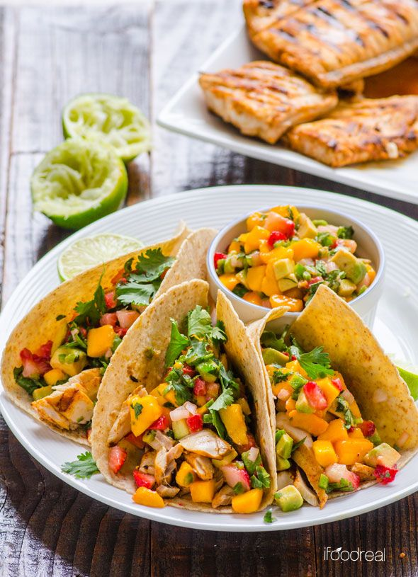 Fish Tacos with Strawberry Mango Salsa Recipe -- Grilled fish wrapped in warm tortilla and topped with sweet and spicy fruity salsa. Delicious, easy and fresh dinner!