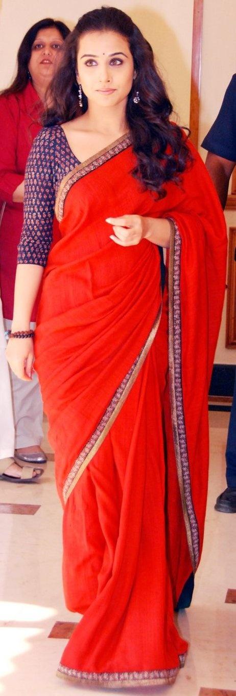 Vidya in fiery red.