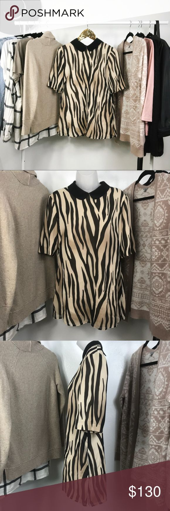 St.John | Silk Animal Print Blouse size 8 In perfect pre loved condition! A gorgeous silk top. Has been dry cleaned. Beautifully double layered with a zebra print. Has a zipper in the back that is really discreet. A gorgeous black collar. An overall gorgeous well made Blouse! St. John Tops Blouses