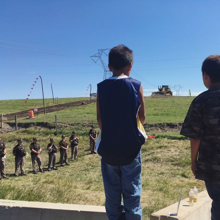 "Photos Show Why The North Dakota Pipeline Is Problematic. ""Two young Lakota boys watch as construction machinery drives onto the Dakota Access Pipeline construction site, just over a mile from the banks of the Missouri River."" Daniella Zalcman"