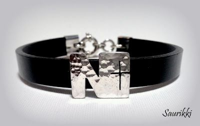 Silver leather braclet with cross