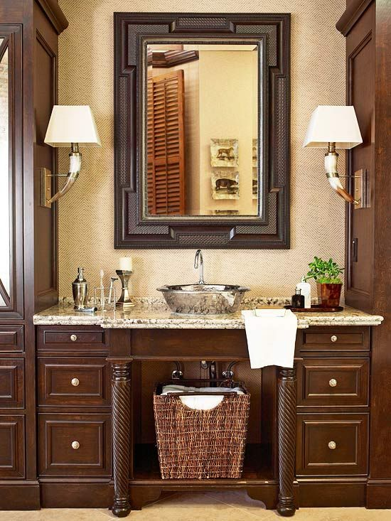 Tons of texture and visual interest in this bathroom! Grass-cloth wallpaper, granite, steer-horn sconces, nickel accents, turned vanity legs, ...Better Homes & Gardens