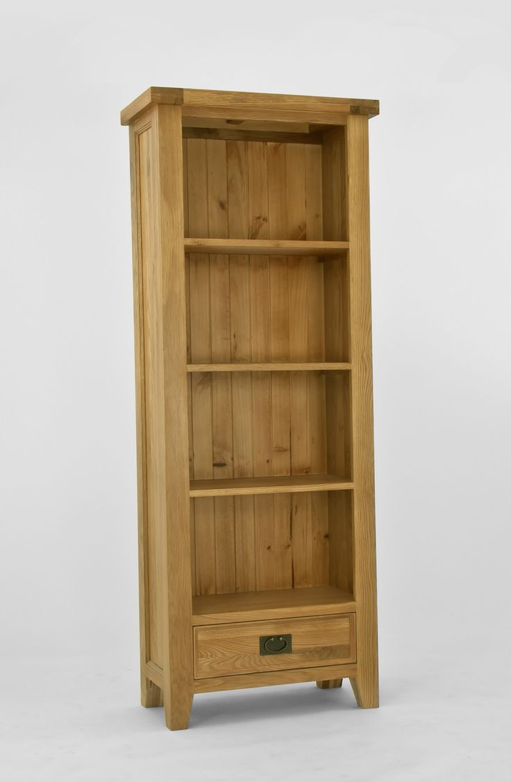 Elegance Oak Medium Bookcase - Elegance Oak is designed with petite proportions which ensure it would suit small rooms as well as large. Crafted from North American oak, this range has a rustic appeal.Crafted using artisan methods, pieces feature tongue and groove panels as well as dovetailed joints. Hand-finished with a light lacquer finish which protects and highlights, pieces are adorned with antiqued brass handles and hinges.