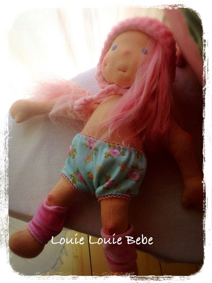 """This 12"""" Louie Louie Bebe, Waldorf doll, has Pink Alpaca hair, a dimple and a lively personality."""