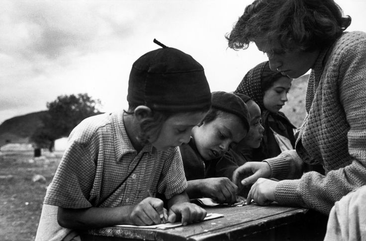 An outdoor school class for immigrant children in the Parod transit camp  (Robert Capa)