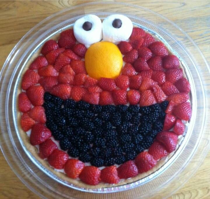 """Sophia's Elmo """"Cake"""" -- pie pan with strawberries, blieberries, a tangerine, two marshamallow eyes with chocolate chip pupils? Healthier than real cake..."""