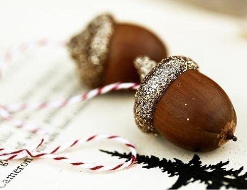 Acorn Ornaments - LOVE THESE  Add some bling to your Thanksgiving table settings with pretty acorn ornaments. Then, save them to hang from your Christmas tree.