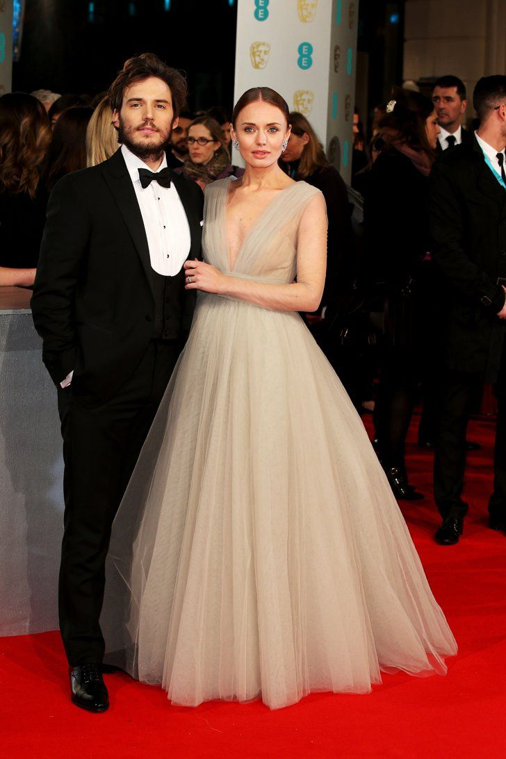 Pin for Later: Stars Go All Out on the BAFTA Awards Red Carpet in London Laura Haddock and Sam Claflin