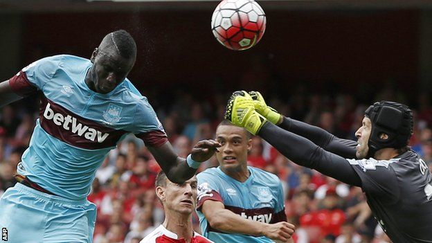 Arsenal's season started with defeat as West Ham won their first Premier League game under manager Slaven Bilic.