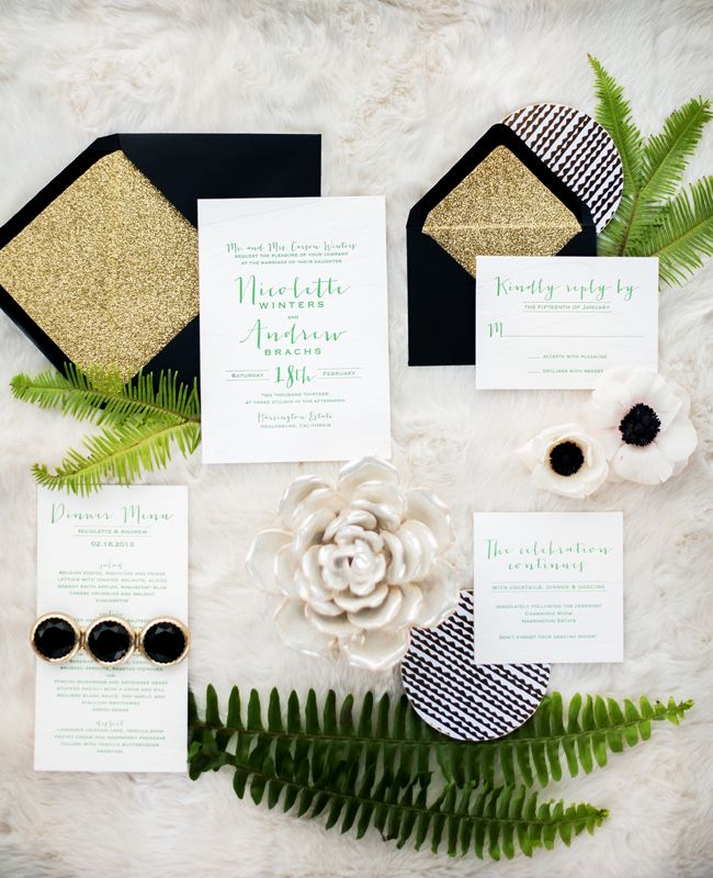 black, white, gold, and green stationery suite
