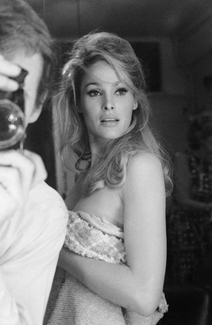 "Swiss actress Ursula Andress wrapped in a towel bettwen takes while working  on ""She"""