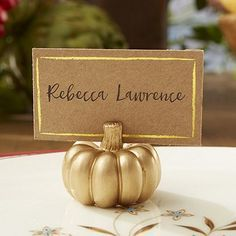 As adorable as they are useful, these miniature metallic gold pumpkin place card holders complete with metallic gold border 2 x 1 Kraft place cards will compliment your autumn table decorations as guests look for their names or table number as they are seated at your fall wedding reception. These place card holder can be ordered at http://myweddingreceptionideas.com/metallic-gold-pumpkin-place-card-holders.asp