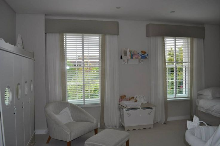 Simple linen sheer curtain with hard padded pelmets.  Made by Teresa