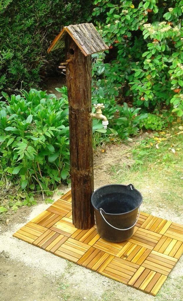 Voili voilou la fontaine terminée avec au sommet une niche pour oiseaux