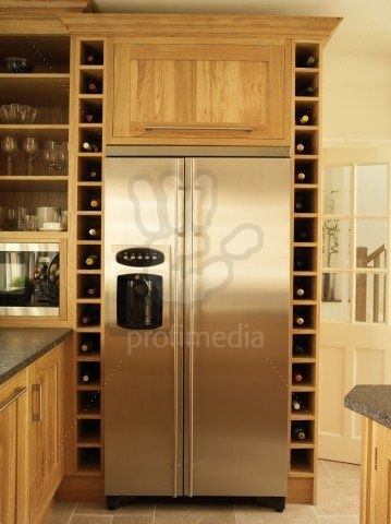 Built In Wine Rack Along Fridge...and FULLY Stocked!