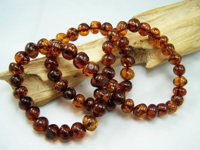 Amber bracelet with unique irregular cognac amber beads on elastic rubber cord.