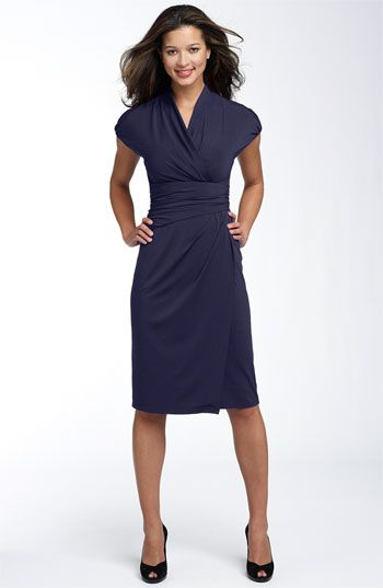 Deep purple knee length business professional dress.