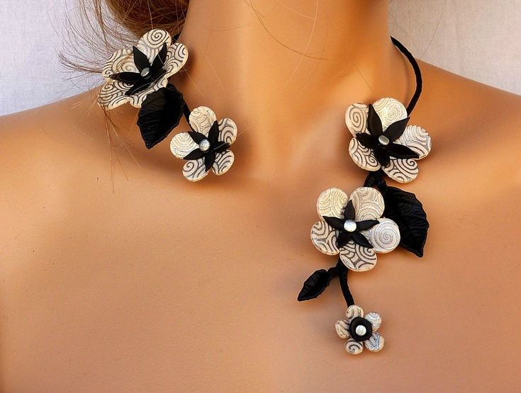 67 best polymer clay earring ideas images on pinterest polymer asymmetric black and white blossoms find this pin and more on polymer clay earring ideas aloadofball Gallery
