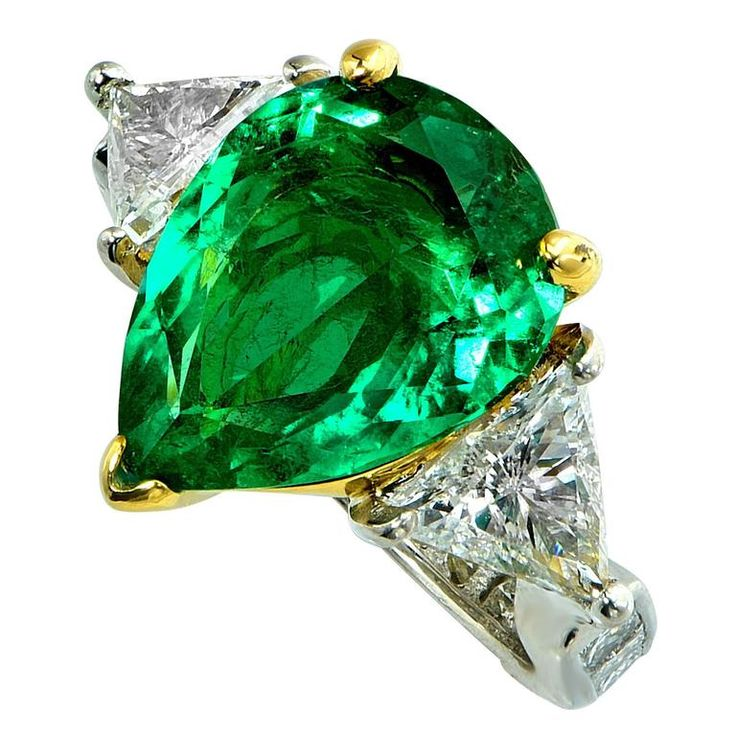 4.34 Carat Emerald Diamond Platinum Ring | From a unique collection of vintage three-stone rings at https://www.1stdibs.com/jewelry/rings/three-stone-rings/