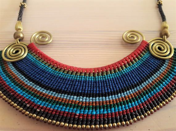 Welcome to Bohemian Style Statement Pieces...  You're looking at the ultimate Bohemian Style Thai accessory, our rainbow bib/choker necklace! Totally adjustable in length to wear to suit your style.     www.bohemianstyleshop.etsy.com