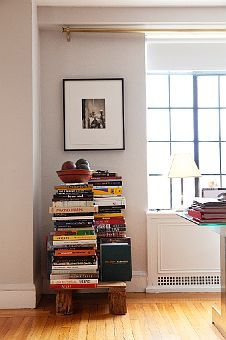 Stacked books to make a table- creates its own sculpture.