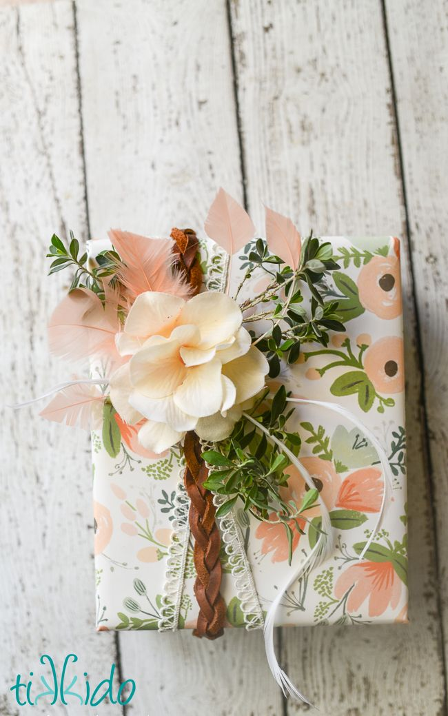 Boho style creative gift wrapping tutorial.  The feathers and leather and lace are the perfect accent for the gorgeous Rifle Paper Co paper.