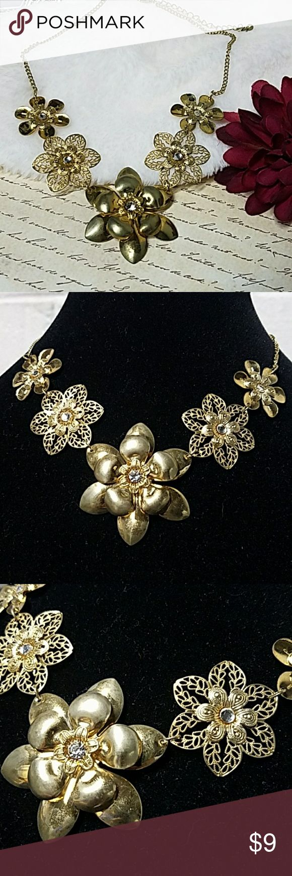 """Gold Mixed Flower Choker/Collar Necklace 16"""" Long w/3"""" extender chain. Mix of gold (solid & filigree) flowers w/Crystal accents. Item#N977 *ALL JEWELRY IS NWT/NWOT/UNUSED VINTAGE* 25% OFF BUNDLES OF 3 OR MORE ITEMS! **ALL REASONABLE OFFERS ACCEPTED** BUY WITH CONFIDENCE~TOP 10% SELLER, FAST SHIPPING,5 STAR RATING, FREE GIFT w/MOST ORDERS! Jesi's Fashionz  Jewelry Necklaces"""