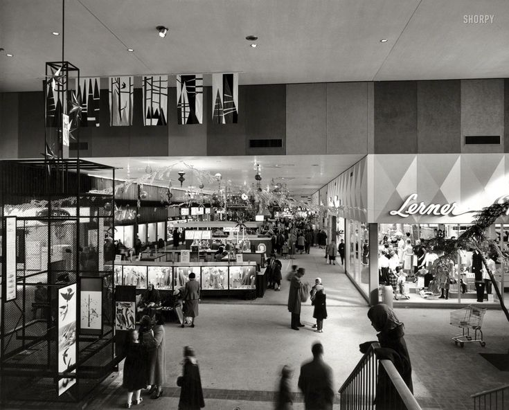 """1958. """"Harundale Mall, Glen Burnie, Maryland. Interior view."""" The first enclosed shopping center on the East Coast."""